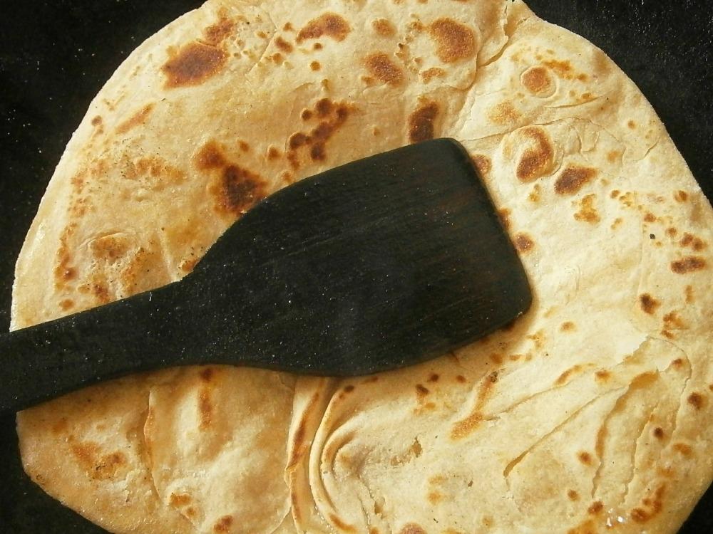 Flatbread with a black spatula
