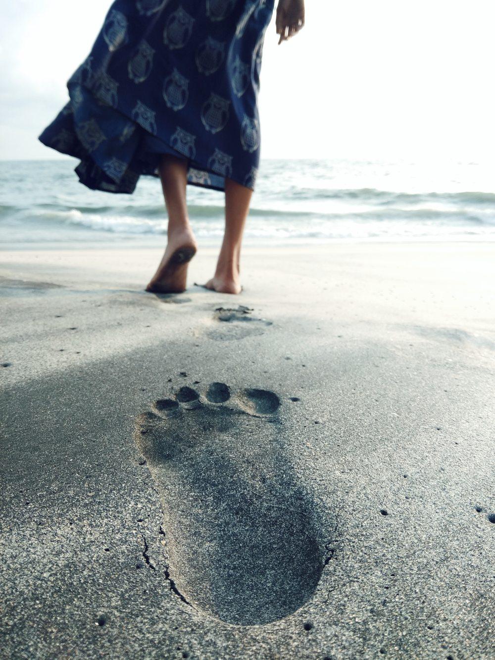 Lady walking on the Beach