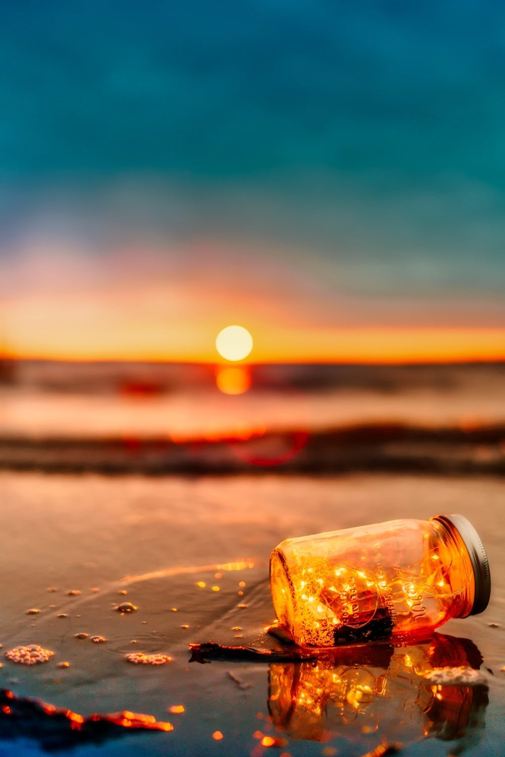 Sunset with a bottle and lights